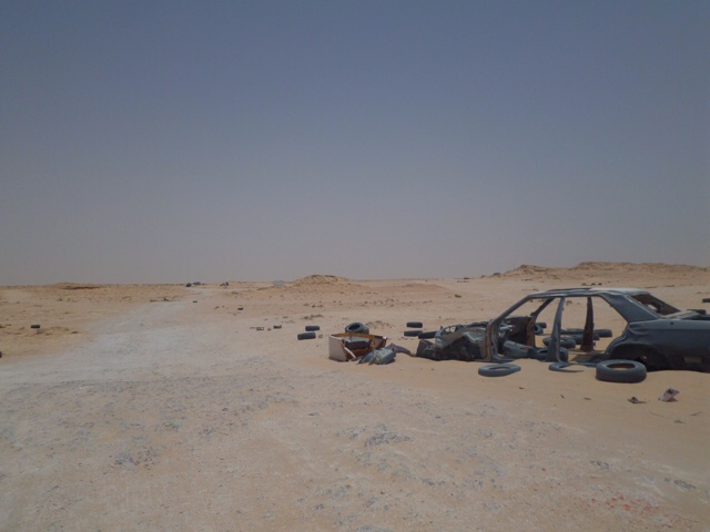Unpaved Border littered with dead cars