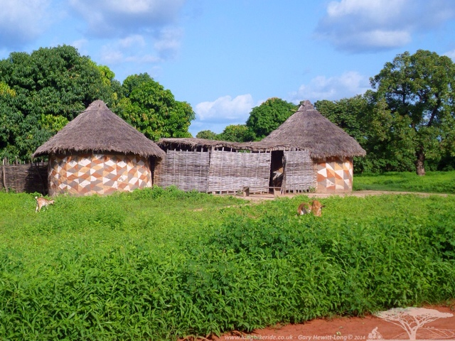 Mud huts, with painting on outside