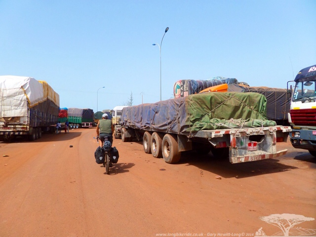 Cycling into Bamako through the Lorries