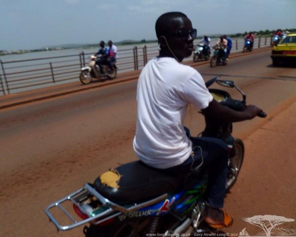 Moto's passing close in Bamako