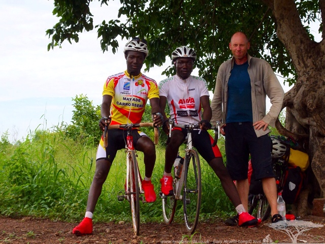 Issaka and his buddy riding road bikes in Burkina Faso