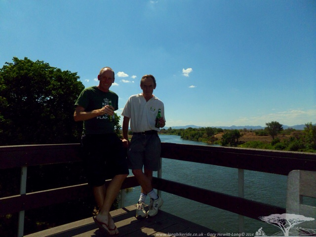 Mike and I having drinks on arrival at Gwabi River Lodge