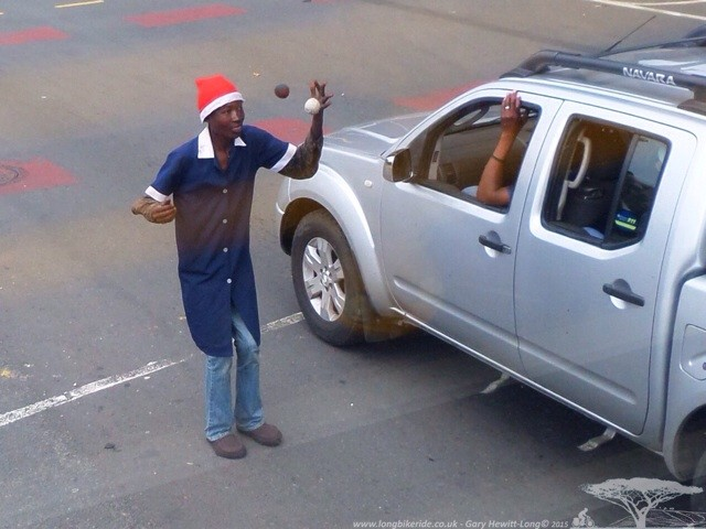 Santa Juggling on the Streets of Johannesburg