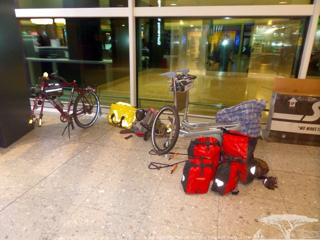Putting the bike back together at Heathrow Airport